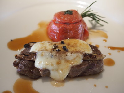 Grilled Iberian Pork and White Asparagus Gratinato served with Salciccia-Stuffed Tomato